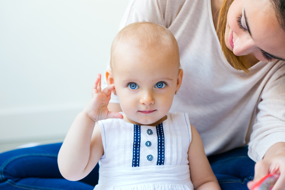 Portrait of Baby girl and her mother playing at home